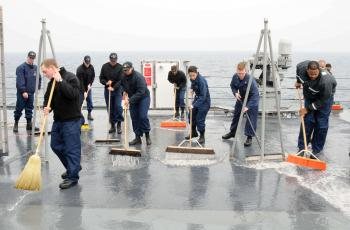 Sailors from the deck and engineering departments aboard U.S. 7th Fleet flagship USS Blue Ridge (LCC 19) clean the weather decks during a fresh water wash down. (U.S. Navy photo by Mass Communication Specialist 3rd Class Brian A. Stone/Released)