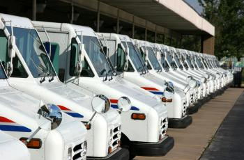 US Postal Service delivery trucks in line