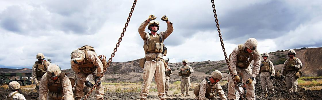 Cpl. Brent Pennington, combat engineer with 7th Engineer Support Battalion, 1st Marine Logistics Group, signals to a crane operator during a bridge building exercise at Marine Corps Base Camp Pendleton, California