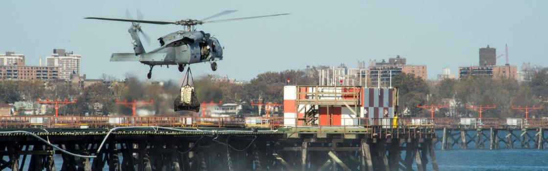 MH-60S Sea Hawk helicopter assigned to Helicopter Sea Combat Squadron (HSC) 9 sling-loads a power generator from LaGuardia Airport