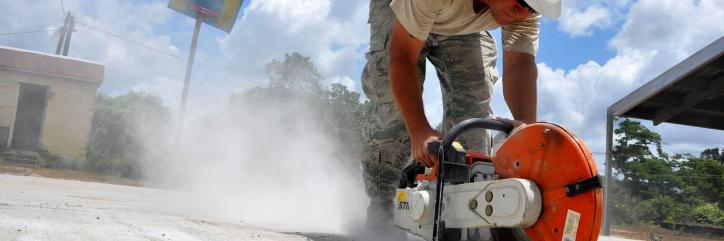 Master Sgt. Donnie Bogan saws cutting lines in concrete, April 27 at the construction site of Crooked Tree Government Primary School in Belize. Civil Engineers from both the U.S. and Belize are constructing various structures at schools throughout Belize as part of an exercise called New Horizons. Building these facilities will support further education for the children of the country and provide valuable training for U.S. and Belizean service members. Bogan is a project manager with the 823rd Red Horse Squ