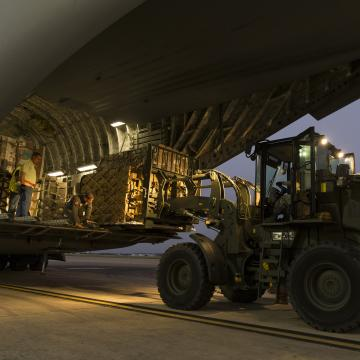 U.S. Airmen with the 502nd Logistics Readiness Squadron load a C-17 Globemaster III at Joint Base San Antonio-Lackland, Texas, for Hurricane Maria relief efforts