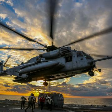 A U.S. Marine Corps CH-53E Super Stallion helicopter with Marine Medium Tiltrotor Squadron (VMM) 162 (Reinforced), 26th Marine Expeditionary Unit (MEU), picks up an AV-8B Harrier engine to transport it from the amphibious assault ship USS Iwo Jima (LHD 7) to the fleet replenishment ship USNS Big Horn (T-AO-198) during a Helicopter Support Team mission as part of Combined Composite Training Unit Exercise (COMPTUEX), Dec. 1, 2017, in the Atlantic Ocean. The exercise allows all elements of the Marine Air Groun
