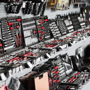 Showcase of tool store. Toolboxes and toolkit in the shop